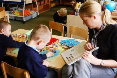 pupils-with-a-teacher-in-class